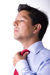 adjusting the necktie