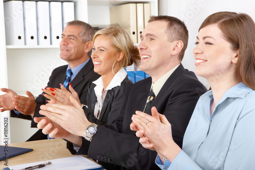 Smiling business group clapping hands