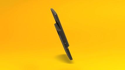 Téléphone portable sur fond jaune