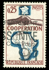 vintage French stamp with handshake and map of Africa