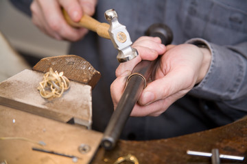 Goldsmith work in process with hammer