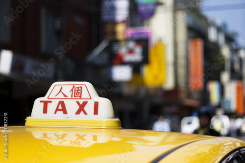 Taxi with Chinese writing on it