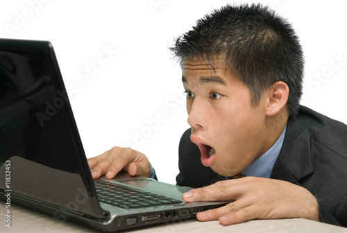 Yuppie staring at laptop screen