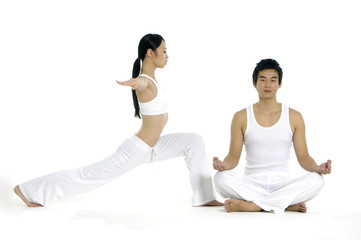 Couple doing yoga exercises together