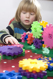 young child learning with some colourful cogs poster