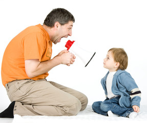 Man yelling at boy