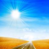 road crossing sandy desert hot daytime poster