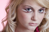 young woman with feather eye lashes closeup poster