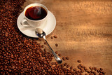 Fototapety White coffee cup with beans on rustic  table