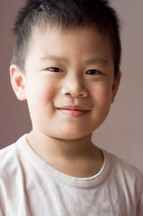 Photo of Asian young boy looking at camera