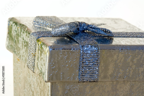 Silver gift on white background