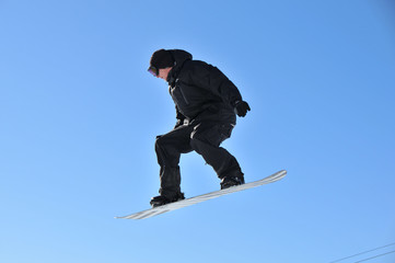 youth on snow board performing aerial skiing
