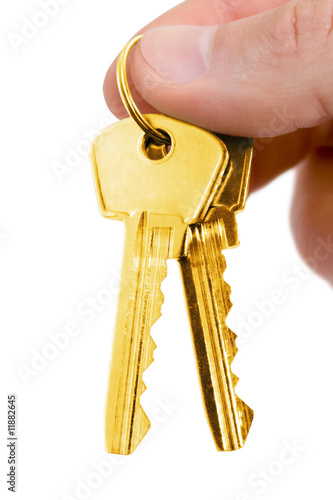 gold key in fingers