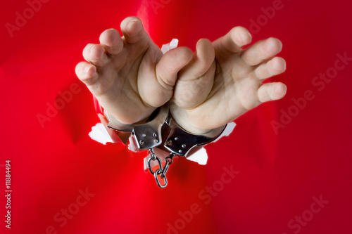 hands in shackles