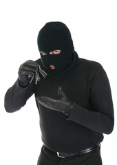 Masked criminal holding keys - Your message here