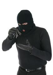 Masked criminal holding keys - Your message here