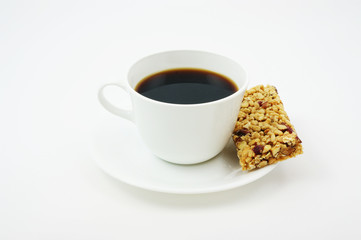 Coffee with an energy bar for a pick me up snack.