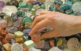 Crystal therapist choosing stones poster