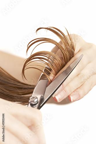 Leinwandbild Motiv hair stylist cutting wet hair with professional scissors