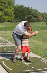 Dad Teaching Son Golf