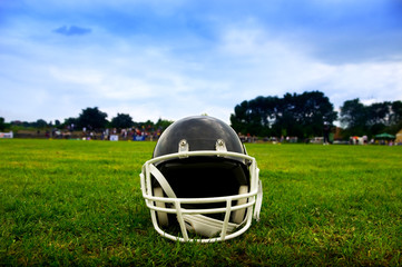 American football helmet in grass