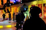 Cameraman works in the studio - recording show in TV studio poster