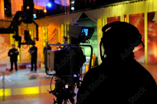 Leinwandbild Motiv Cameraman works in the studio - recording show in TV studio