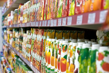 Shelves with fruit juices in boxes in a supermarket
