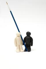 Two Plasticine men hold a brush