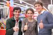 Three friends make gesture ok  in shop