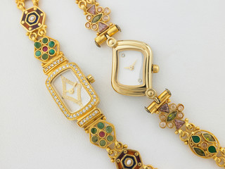 Two designed gold watches