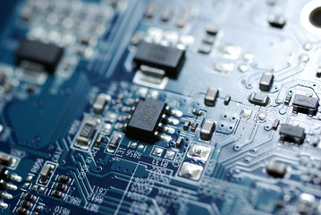 Close up photo of blue PC circuit board.