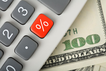 dollars and calculator with percent red button