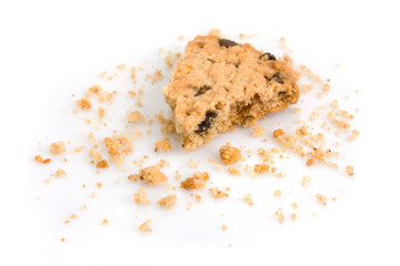 Last bite of a chocolate chip cookie with crumbs
