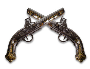 Old flintlock pistols isolated on white background