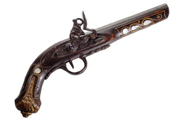 Old flintlock pistol isolated on white background