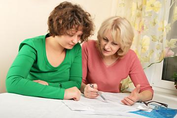 Adult and young women with documents