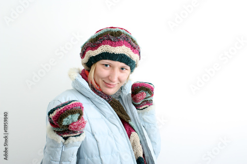 The woman in winter clothes.