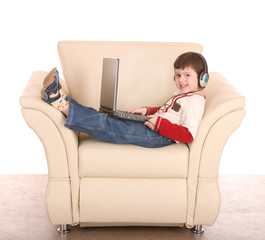 Boy with laptop and headphone.