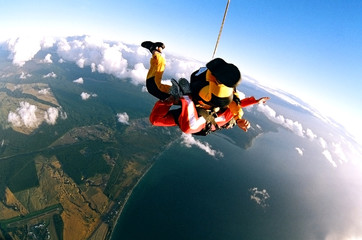 Skydivers over coast