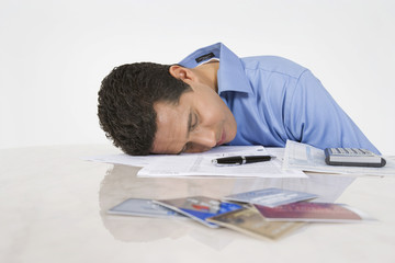 Man Exhausted from Paying Bills