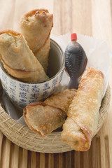 crispy spring rolls with soy sauce to take away (asia)