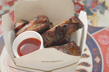 crispy fried pork ribs with sauce to take away