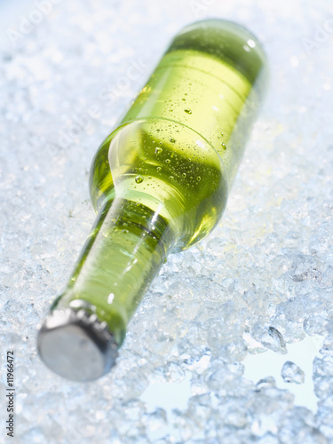 bottle of beer on crushed ice