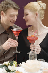 couple with drinks at romantic meal