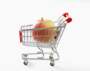 apple in toy shopping trolley