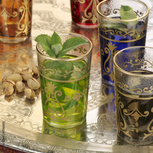 peppermint tea in middle eastern glasses, pistachios