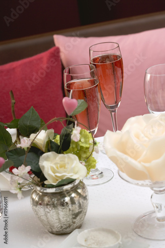 two glasses of pink champagne on romantic table