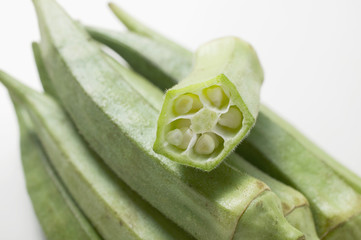 several okra pods, one halved (close-up)
