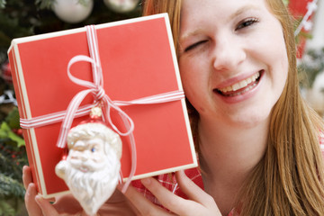 woman holding christmas parcel